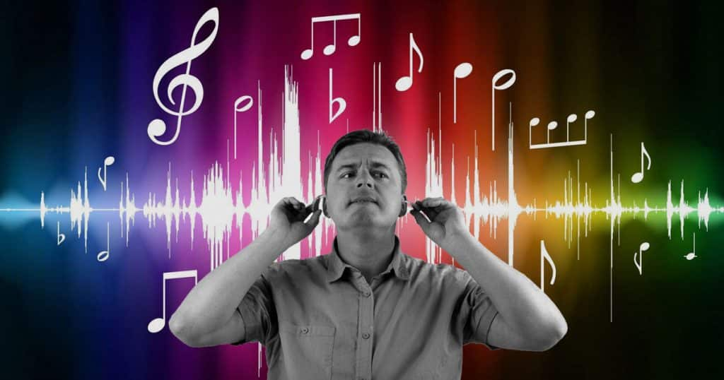 Man looking for musical inspiration among sound waves and musical notes
