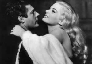 Still frame of La Dolce Vita with Marcello Mastroianni embracing to Anita Ekberg