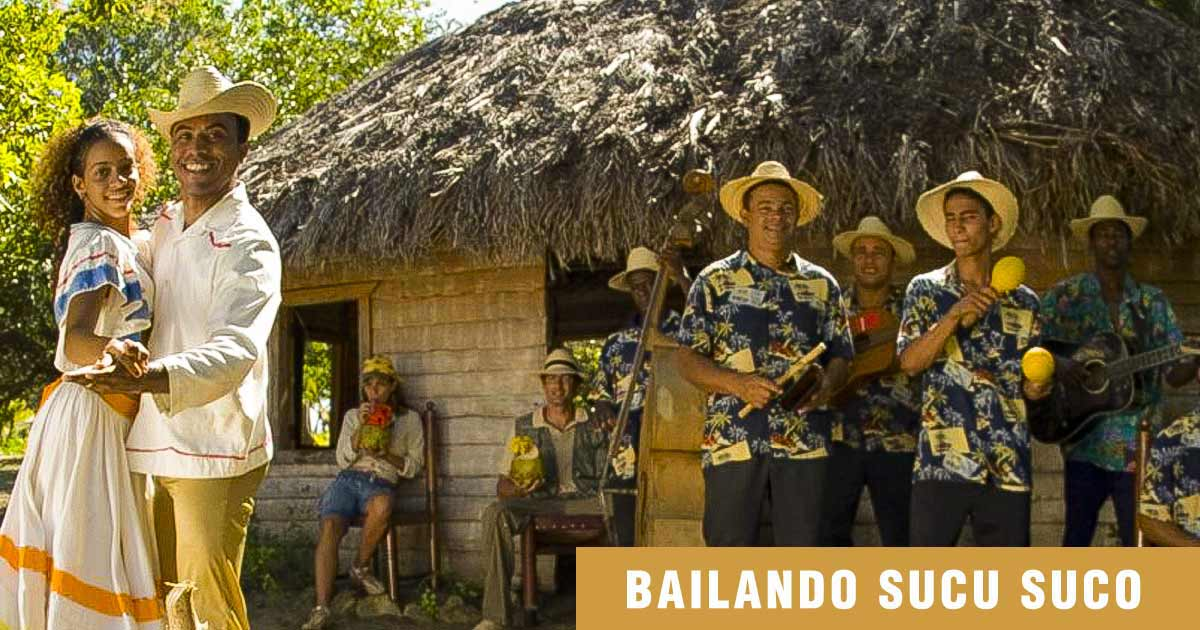 Couple of Cuban farmers with typical clothes around a country house