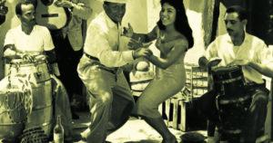 Dance couple and conga players
