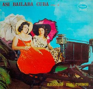 "two cuban girls in a ""volanta"" type of carruage very tipical in XIX century"